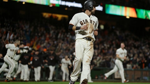 <p>               San Francisco Giants' Steven Duggar crosses home plate to score as his teammates rush to greet Gorkys Hernandez after he hit a walk-off single against Jake Diekman in the ninth inning of a baseball game, Tuesday, Aug. 28, 2018, in San Francisco. San Francisco won the game 1-0. (AP Photo/Eric Risberg)             </p>