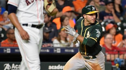 <p>               Oakland Athletics' Ramon Laureano, right, runs home to score on Nick Martini's RBI double, as Houston Astros relief pitcher Roberto Osuna, left, watches during the ninth inning of a baseball game, Tuesday, Aug. 28, 2018, in Houston. (AP Photo/Eric Christian Smith)             </p>