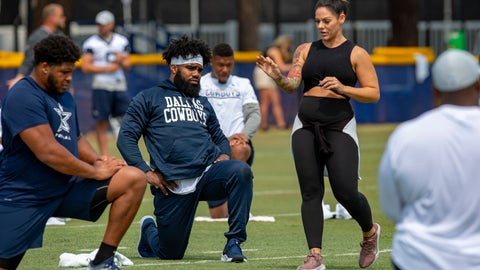 <p>               FILE - In this July 28, 2018, file photo, Dallas Cowboys offensive tackle La'el Collins, left and running back Ezekiel Elliott, center, listen to yoga instructor Stacey Hickman, right, as the team does some flexibility exercises at NFL football training camp in Oxnard, Calif. (AP Photo/Gus Ruelas, File)             </p>