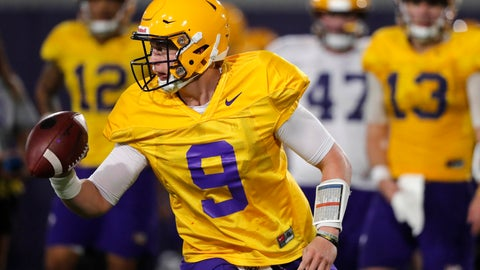 <p>               LSU quarterback Joe Burrow (9) runs through drills during their NCAA college football practice in Baton Rouge, La., Monday, Aug. 6, 2018. The former Ohio State quarterback played behind the dynamic J.T. Barrett for two seasons. Burrow will compete for a starting job with the Tigers, who are installing a spread attack under new offensive coordinator Steve Ensminger. (AP Photo/Gerald Herbert)             </p>