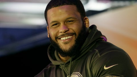 <p>               FILE - This Oct. 22, 2016, file photo shows Los Angeles Rams defensive tackle Aaron Donald on stage during an NFL Fan Rally in London. All-Pro defensive tackle Aaron Donald has agreed to a massive new contract with the Los Angeles Rams, ending his second consecutive preseason holdout as the highest-paid defensive player in NFL history. The Rams on Friday, Aug. 31, 2018, announced a new six-year deal through 2024 for Donald, the reigning NFL Defensive Player of the Year.  (AP Photo/Tim Ireland, File)             </p>