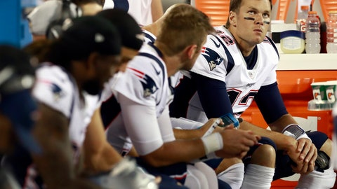 <p>               New England Patriots' Tom Brady (12) watches from the bench with teammates during the second half of a preseason NFL football game against the Carolina Panthers in Charlotte, N.C., Friday, Aug. 24, 2018. (AP Photo/Jason E. Miczek)             </p>