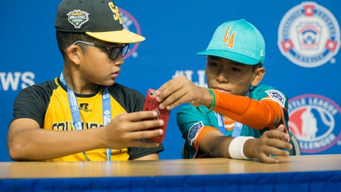 <p>               In this photo provided by Georgianna DeCarmine, Georgia shortstop Tai Peete, left, uses Google Translate on his phone to communicate with Panama outfielder Rolando Rodriguez during an interview at the Little League World Series in South Williamsport, Pa., Tuesday, Aug. 14, 2018. (Georgianna DeCarmine via AP)             </p>