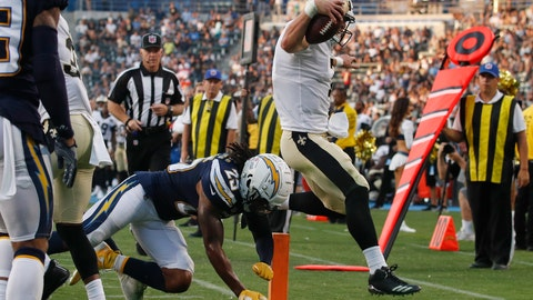 <p>               New Orleans Saints quarterback Taysom Hill, right, scores a touchdown as Los Angeles Chargers defensive back Rayshawn Jenkins tries to push him out of bounds during the second half of an NFL preseason football game Saturday, Aug. 25, 2018, in Carson, Calif. (AP Photo/Jae C. Hong)             </p>