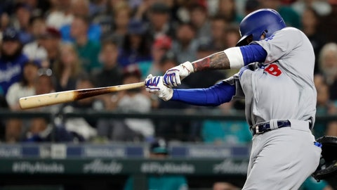 <p>               Los Angeles Dodgers' Manny Machado hits a two-run home run during the seventh inning of the team's baseball game against the Seattle Mariners, Friday, Aug. 17, 2018, in Seattle. It was Machado's second home run of the game. (AP Photo/Ted S. Warren)             </p>
