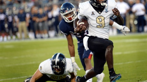 <p>               Central Florida running back Adrian Killins Jr. (9) runs the ball in for a touchdown during the first half of an NCAA college football game against Connecticut on Thursday, Aug. 30, 2018, in East Hartford, Conn. (AP Photo/Stephen Dunn)             </p>