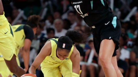 <p>               Seattle Storm's Jordin Canada stumbles as she is fouled by New York Liberty's Amanda Zahui B in a WNBA basketball game, Monday, Aug. 6, 2018, in New York. (AP Photo/Mark Lennihan)             </p>