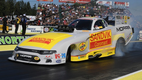 <p>               In this photo provided by the NHRA, Matt Hagan drives in Funny Car No. 1 qualifying Saturday, Aug. 4, 2018, at the CatSpot NHRA Northwest Nationals drag races at Pacific Raceways in Kent, Wash. Hagan took the No. 1 qualifying spot. (Jerry Foss/NHRA via AP)             </p>