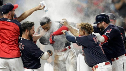 <p>               Cleveland Indians' Francisco Lindor, center, is welcomed by teammates after he hit a walk-off three-run home run against the Minnesota Twins in a baseball game Wednesday, Aug. 8, 2018, in Cleveland. The Indians won 5-2. (AP Photo/Tony Dejak)             </p>
