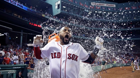 <p>               Boston Red Sox's Eduardo Nunez is doused with water after reaching first on a throwing error, driving in J.D. Martinez and breaking a 7-7 tie, during the bottom of the ninth inning of a baseball game against the Miami Marlins at Fenway Park in Boston, Tuesday, Aug. 28, 2018. (AP Photo/Charles Krupa)             </p>