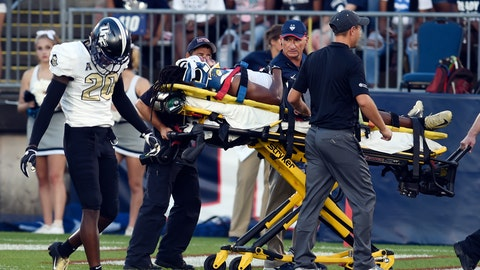 <p>               Central Florida defensive back Aaron Robinson is taken off the field after being injured on the opening kickoff in the team's NCAA college football game against Connecticut on Thursday, Aug. 30, 2018, in East Hartford, Conn. (AP Photo/Stephen Dunn)             </p>
