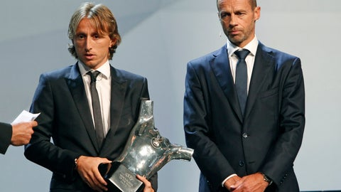 <p>               Luka Modric, left, holds his UEFA Men's Player of the Year trophy as he stands next to UEFA President Aleksander Ceferin during the UEFA Champions League draw at the Grimaldi Forum, in Monaco, Thursday, Aug. 30, 2018. (AP Photo/Claude Paris)             </p>