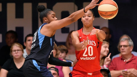 <p>               Washington Mystics guard Kristi Toliver, right, passes the ball against Atlanta Dream guard Alex Bentley, left, during the first half of Game 3 of a WNBA basketball playoffs semifinal Friday, Aug. 31, 2018, in Washington. (AP Photo/Nick Wass)             </p>