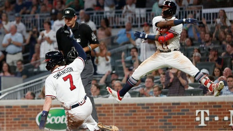 <p>               Atlanta Bravess Ronald Acuna Jr. reacts as Dansby Swanson (7) scores on a Julio Terheran base hit during the fifth inning of a baseball game against the Colorado Rockies on Thursday, Aug. 16, 2018, in Atlanta. The Rockies won 5-3. (AP Photo/John Bazemore)             </p>