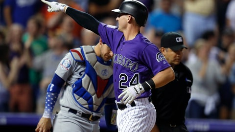 <p>               Colorado Rockies' Ryan McMahon, front, gestures as he crosses home plate after hitting a two-run home run, next to Los Angeles Dodgers catcher Yasmani Grandal during the seventh inning of a baseball game Friday, Aug. 10, 2018, in Denver. (AP Photo/David Zalubowski)             </p>