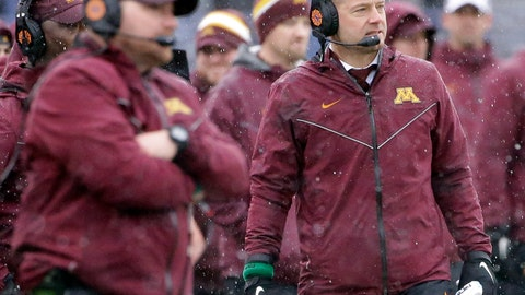 <p>               File-This Nov. 18, 2018, file photo shows Minnesota head coach P.J. Fleck reacting as he watches his team against Northwestern during the first half of an NCAA college football game in Evanston, Ill. After scoring became a struggle down the stretch of head coach Fleck's first season at Minnesota, the Gophers face another uphill climb on offense with a quarterback, either Tanner Morgan or Zack Annexstad, who has yet to take a snap in a college game. (AP Photo/Nam Y. Huh, File)             </p>