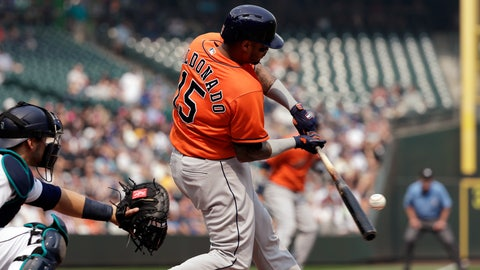 <p>               Houston Astros' Martin Maldonado singles in a run as Seattle Mariners catcher Mike Zunino looks on in the second inning of a baseball game Wednesday, Aug. 22, 2018, in Seattle. (AP Photo/Elaine Thompson)             </p>