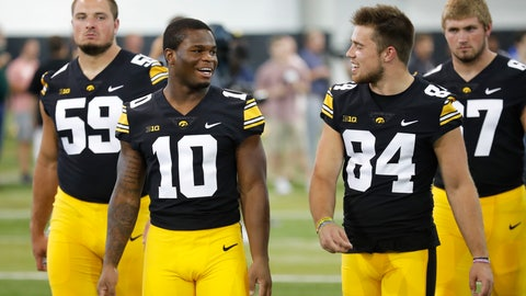 <p>               Iowa running back Mekhi Sargent (10) talks with wide receiver Nick Easley (84) during an NCAA college football media day, Friday, Aug. 10, 2018, in Iowa City, Iowa. (AP Photo/Charlie Neibergall)             </p>
