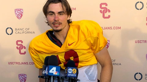 <p>               Southern California quarterback J.T. Daniels speaks to reporters following his first NCAA college football practice after winning the Trojans' starting job, Tuesday, Aug. 28, 2018, in Los Angeles. The 18-year-old Daniels will be the first true freshman to start at quarterback for USC's powerhouse program since 2009. (AP Photo/Greg Beacham)             </p>