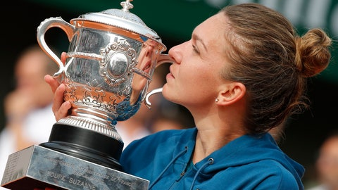 <p>               FILE - In this June 9, 2018, file photo, Romania's Simona Halep holds the trophy as she celebrates winning the final in the French Open tennis tournament against Sloane Stephens of the United States, 3-6, 6-4, 6-1, at Roland Garros stadium in Paris. Halep is the women's No. 1 seed in the U.S. Open, which starts Monday, Aug. 27. (AP Photo/Michel Euler, File)             </p>