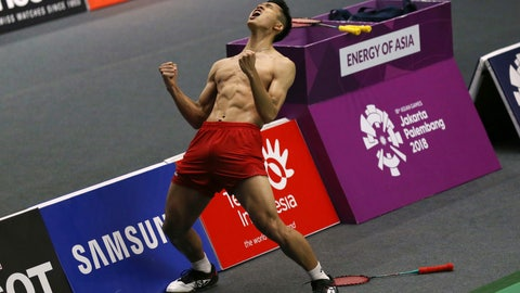 <p>               Jonatan Christie of Indonesia celebrates after defeating Kenta Nishimoto of Japan during their men's badminton singles semifinal match at the 18th Asian Games in Jakarta, Indonesia, Monday, Aug. 27, 2018. (AP Photo/Achmad Ibrahim)             </p>