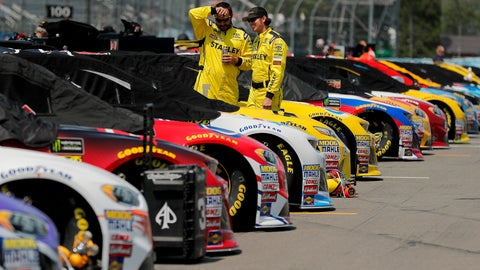 <p>               Pit crew members for Daniel Suarez talk while checking the car on pit road before a NASCAR Cup series auto race, Sunday, Aug. 5, 2018, in Watkins Glen, N.Y. (AP Photo/Julie Jacobson)             </p>