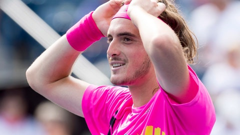 <p>               Stefanos Tsitsipas, of Greece, celebrates after defeating Novak Djokovic, of Serbia, at the Rogers Cup men's tennis tournament in Toronto, Thursday, Aug. 9, 2018. (Frank Gunn/The Canadian Press via AP)             </p>