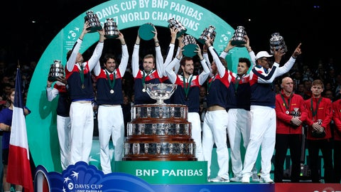 <p>               FILE - In this Nov. 26, 2017, file photo, members of the French team lift up their trophies after France won the Davis Cup final at the Pierre Mauroy stadium in Lille, northern France. The Davis Cup will be decided with a season-ending, 18-team tournament beginning next year. The new format replaces the one in which the Davis Cup is played over four weekends throughout the year.  (AP Photo/Christophe Ena, File)             </p>