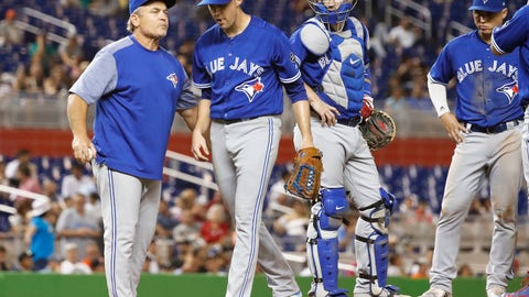 <p>               Toronto Blue Jays starting pitcher Aaron Sanchez, second from left, leaves the mound as manager John Gibbons, left, takes him out of a baseball game during the fifth inning against the Miami Marlins, Friday, Aug. 31, 2018, in Miami. (AP Photo/Brynn Anderson)             </p>