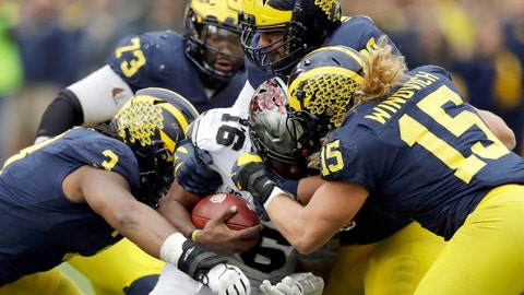 <p>               FILE - In this Nov. 25, 2017, file photo, Ohio State quarterback J.T. Barrett (16) is sacked by Michigan defensive linemen Rashan Gary (3) and Chase Winovich (15) during the second half of an NCAA college football game in Ann Arbor, Mich. When No. 12 Notre Dame has the ball Saturday night, No. 14 Michigan may have the advantage. The Wolverines appear to be loaded on defense with NFL-caliber players up front, at linebacker and in the secondary. (AP Photo/Carlos Osorio, File)             </p>