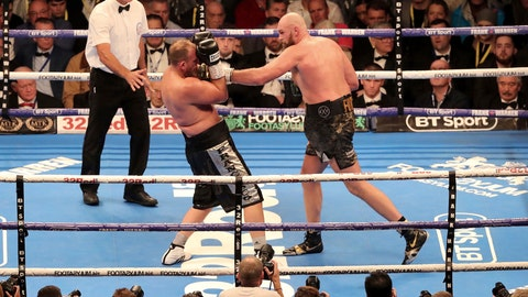 <p>               Tyson Fury, right, in action against Francesco Pianeta during their Heavyweight fight at Windsor Park in Belfast, Northern Ireland, Saturday Aug. 18, 2018. fury went on to win the bout. (Niall Carson/PA via AP)             </p>