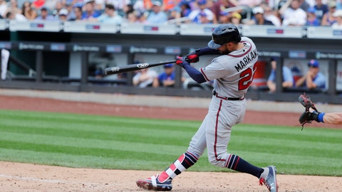 <p>               Atlanta Braves' Nick Markakis hits a home run during the tenth inning of a baseball game against the New York Mets Sunday, Aug. 5, 2018, in New York. (AP Photo/Frank Franklin II)             </p>
