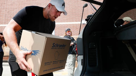 <p>               In this Sunday, Sept. 3, 2017, photo, Houston Texans defensive end J.J. Watt places a box of relief supplies in the back of a vehicle to people impacted by Hurricane Harvey, in Houston. Watt said Monday, Aug. 27, 2018, that he has distributed the $41.6 million his foundation raised to help rebuild the Texas Gulf Coast after Hurricane Harvey. (Brett Coomer/Houston Chronicle via AP, Pool)             </p>