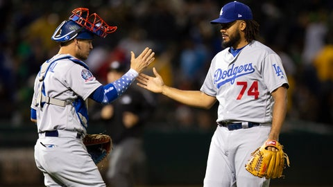 <p>               Los Angeles Dodgers catcher Yasmani Grandal (9) and pitcher Kenley Jansen (74) celebrate the team's 4-2 victory over the Oakland Athletics in a baseball game, Tuesday, Aug. 7, 2018, in Oakland, Calif. (AP Photo/D. Ross Cameron)             </p>