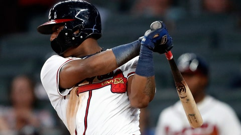<p>               Atlanta Braves left fielder Ronald Acuna Jr. (13) drives in a run with a single in the sixth inning of the second baseball game of a doubleheader against the Miami Marlins Monday, Aug. 13, 2018 in Atlanta. There Braves won 6-1. (AP Photo/John Bazemore)             </p>