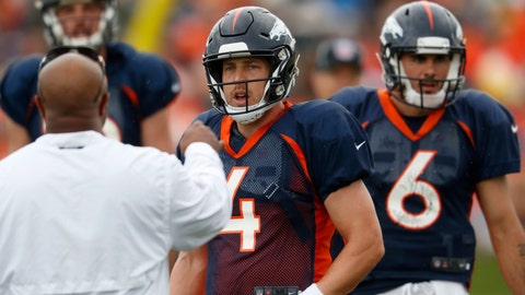 <p>               Denver Broncos running backs coach Curtis Bodkins, front, directs quarterbacks Case Keenum, center, and Paxton Lynch, back left, and Chad Kelly during drills at the team's headquarters during an NFL football training camp Sunday, Aug. 5, 2018, in Englewood, Colo. (AP Photo/David Zalubowski)             </p>