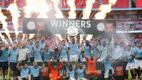 <p>               Manchester City players celebrate with the trophy after they won the Community Shield soccer match between Chelsea and Manchester City at Wembley, London, Sunday, Aug. 5, 2018. (AP Photo/Tim Ireland)             </p>