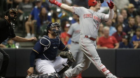 <p>               Cincinnati Reds' Scooter Gennett hits a home run during the ninth inning of a baseball game against the Milwaukee Brewers Tuesday, Aug. 21, 2018, in Milwaukee. (AP Photo/Morry Gash)             </p>