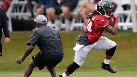 <p>               Atlanta Falcons running back Devonta Freeman (24) runs past an unidentified coach during NFL football training camp Thursday, Aug. 2, 2018 in Flowery Branch, Ga. (AP Photo/John Bazemore)             </p>