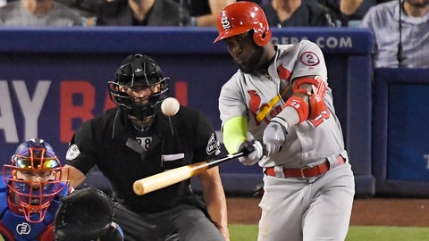 <p>               St. Louis Cardinals' Marcell Ozuna, right, hits a two-run home run as Los Angeles Dodgers catcher Yasmani Grandal, left, and home plate umpire Jim Wolf watch during the seventh inning of a baseball game, Tuesday, Aug. 21, 2018, in Los Angeles. (AP Photo/Mark J. Terrill)             </p>