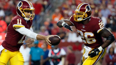 <p>               File-This Aug. 24, 2018, file photo shows Washington Redskins quarterback Alex Smith (11) handing the ball off to running back Adrian Peterson (26) during the first half of a preseason NFL football game against the Denver Broncos in Landover, Md. Smith and Peterson sat a few feet away from each other as fresh-faced college players at the Heisman Trophy ceremony in New York in late 2005 and never imaged this would happen. Twelve NFL seasons later for Smith and 11 for Peterson and they're now in the same backfield together with the Washington Redskins.  (AP Photo/Alex Brandon, File)             </p>