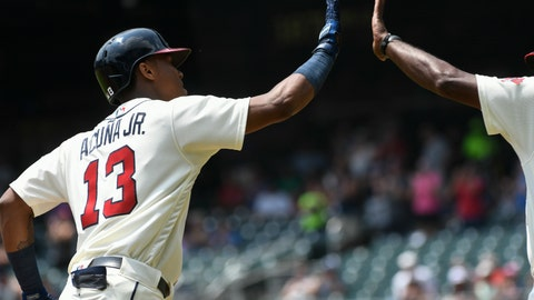 <p>               Atlanta Braves' Ronald Acuna Jr. (13) rounds third base on his home run during the first inning of the first game in a baseball doubleheader against the Miami Marlins, Monday, Aug. 13, 2018, in Atlanta. (AP Photo/John Amis)             </p>