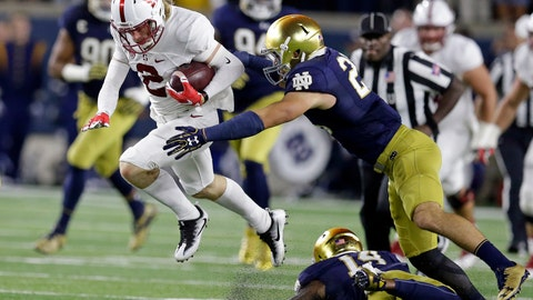 <p>               File- This Oct. 15, 2016, file photo shows Stanford wide receiver Trenton Irwin (2) leaping over Notre Dame safety Devin Studstill (14) as he's tackled by safety Drue Tranquill (23) during the first quarter of an NCAA college football game in South Bend, Ind. Notre Dame head football coach Brian Kelly thinks his players' familiarity with new defensive coordinator Clark Lea's defense will breed contempt for the opposition this fall. Tranquill, a rover last year, returns for his fifth season at weakside linebacker position. (AP Photo/Michael Conroy, File)             </p>