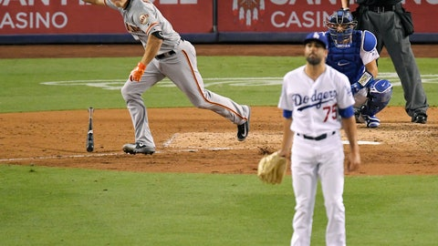 <p>               San Francisco Giants' Nick Hundley, left, celebrates as he hits a two-RBI single as Los Angeles Dodgers relief pitcher Scott Alexander, center, watches along with catcher Austin Barnes during the ninth inning of a baseball game, Monday, Aug. 13, 2018, in Los Angeles. (AP Photo/Mark J. Terrill)             </p>