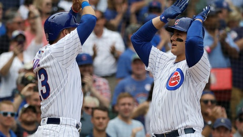 <p>               Chicago Cubs' Anthony Rizzo, right, celebrates with David Bote after hitting a two-run home run during the first inning of a baseball game against the Milwaukee Brewers, Wednesday, Aug. 15, 2018, in Chicago. (AP Photo/Nam Y. Huh)             </p>