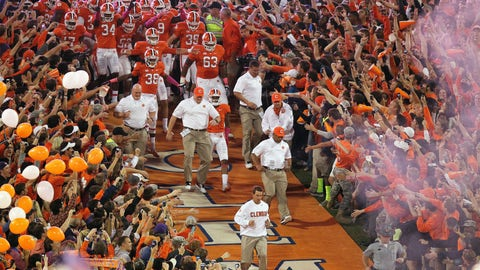 <p>               FILE - In this Oct. 19, 2013, file photo, Clemson head coach Dabo Swinney leads the team down the lane before the first half of an NCAA college football game against the Florida State, in Clemson, S.C. (AP Photo/Mike Stewart, File)             </p>