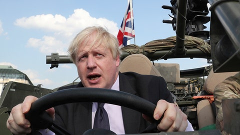 "<p>               FILE - In this file photo dated Thursday, June 21, 2018, Britain's Foreign Secretary Boris Johnson talks during a ceremony at the Tomb of the Unknown Soldier in Warsaw, Poland. The chairman of Britain's governing Conservative Party Brandon Lewis on Tuesday Aug. 7, 2018, asked former Foreign Secretary Boris Johnson to apologize for a newspaper column written by Johnson, that said burqa-wearing women looked like ""letter boxes"". (AP Photo/Czarek Sokolowski, FILE)             </p>"