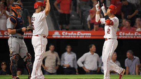 <p>               Los Angeles Angels' Andrelton Simmons, right, celebrates with Albert Pujols, center, after hitting a two-run home run as Detroit Tigers catcher James McCann during the fourth inning of a baseball game Monday, Aug. 6, 2018, in Anaheim, Calif. (AP Photo/Mark J. Terrill)             </p>