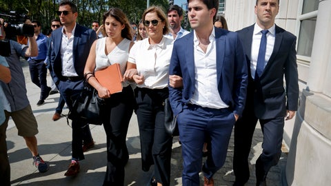 <p>               The family of Juan Angel Napout, a former top South American FIFA  soccer official, including his wife Karin Forster, center, leaves federal court following Napout's sentencing, Wednesday Aug. 29, 2018, in the Brooklyn borough of New York. Napout, of Paraguay was sentenced to nine years in prison in the sprawling FIFA bribery scandal. (AP Photo/Bebeto Matthews)             </p>