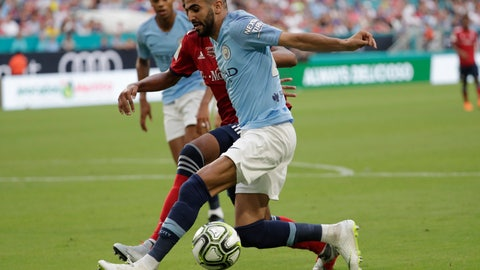 <p>               Manchester City's Riyad Mahrez, right, goes for the ball during the first half of an International Champions Cup tournament soccer match against FC Bayern, Saturday, July 28, 2018, in Miami Gardens, Fla. (AP Photo/Lynne Sladky)             </p>